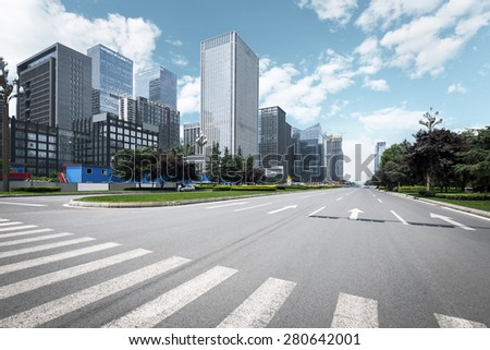 Empty urban road and modern skyline - stock photo