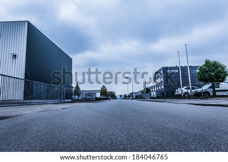 Empty urban street early morning with dramatic sky - stock photo