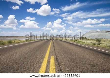 Empty US highway Route 66 in Arizona. The painted desert is visible in the distance. - stock photo