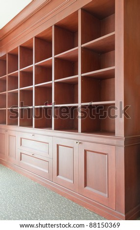 empty useful wooden shelves tilted out to left - stock photo
