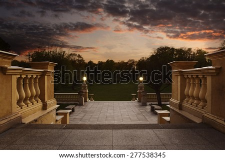 Empty vintage entrance to the garden at the sunset with copy space - stock photo