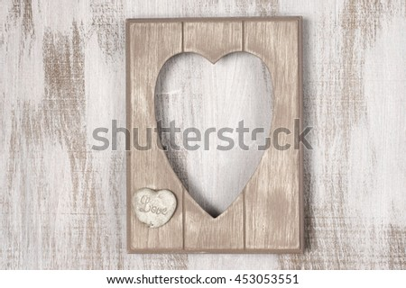 Empty vintage wooden heart shape photo frame on rustic wood background. Top view point. - stock photo