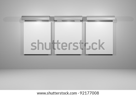 Empty wall advertising board isolated grey wall with lamp for each board