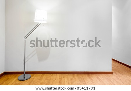 Empty wall with copy space and lamp - stock photo