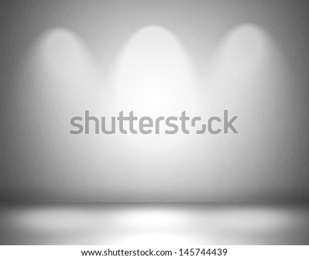 Empty wall with spot lights - stock photo