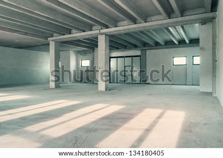 Empty warehouse wall or commercial area, industrial background - stock photo