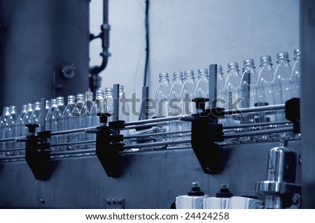 empty water bottles on a factory production line - stock photo