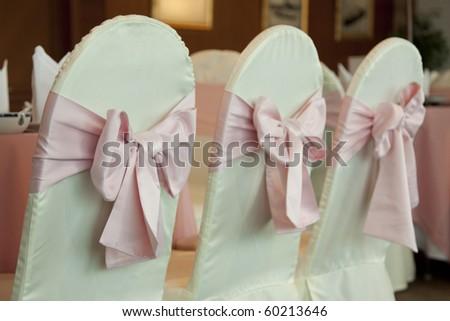 Empty wedding chairs elegantly decorated - stock photo