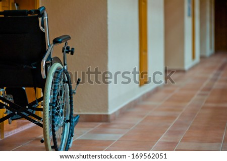 empty wheelchair in the hallway for the disabled - stock photo