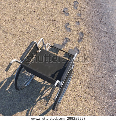 Empty wheelchair on a beach of sand with footprints concept background - stock photo