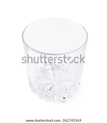 Empty whiskey tumbler glass isolated over the white background - stock photo