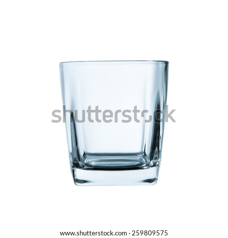 Empty whisky glass on white background. - stock photo