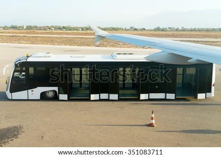 Empty white airport bus. Aviation service. - stock photo