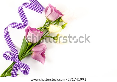 Empty white background with colorful flowers and purple ribbon - stock photo