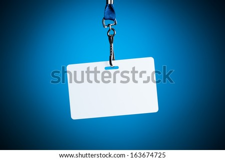 empty white badge backdrop against blue background