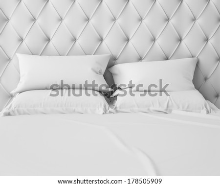 empty white bed and pillows with luxury headboard
