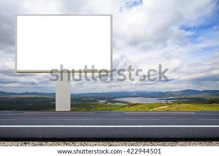 Empty white billboard on outside road. - stock photo