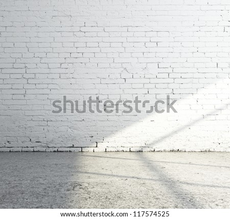 empty white brick room and sunlight - stock photo