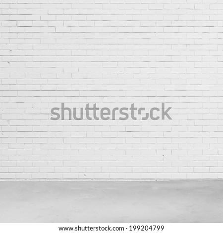 Empty white brick wall and concrete floor. - stock photo
