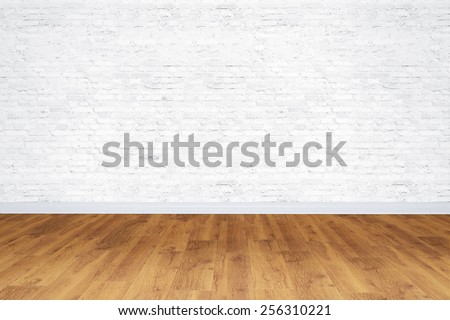 Empty white bricks room with wooden floor - stock photo