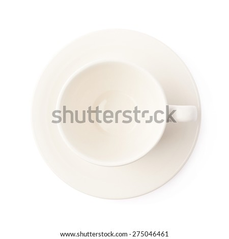 Empty white ceramic tea or coffee cup on a plate, composition isolated over the white background, top view above foreshortening - stock photo