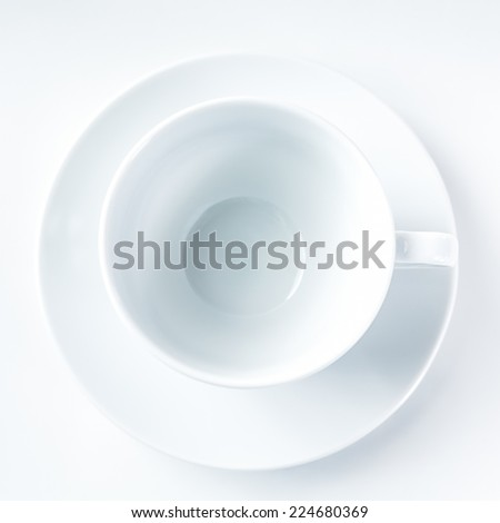 Empty white coffee cup on white background. Top view. - stock photo