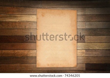 Empty white Crumpled paper on wood table vertical - stock photo
