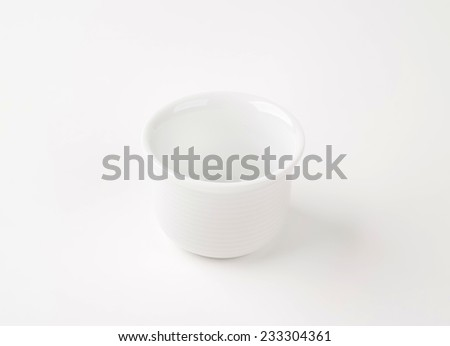 empty white cup on white background