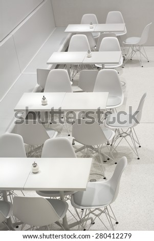 Empty White Interior Restaurant Tables in Modern European Architectural Style - stock photo