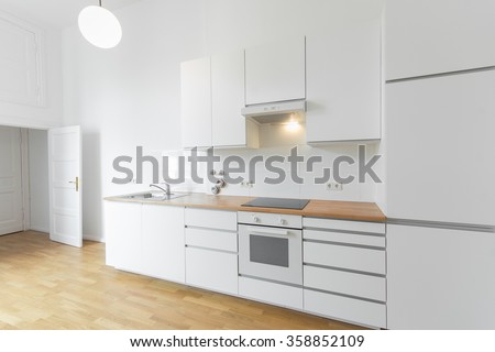 empty white kitchen, new renovated flat - stock photo