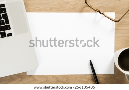 empty white note paper on the office desk - stock photo