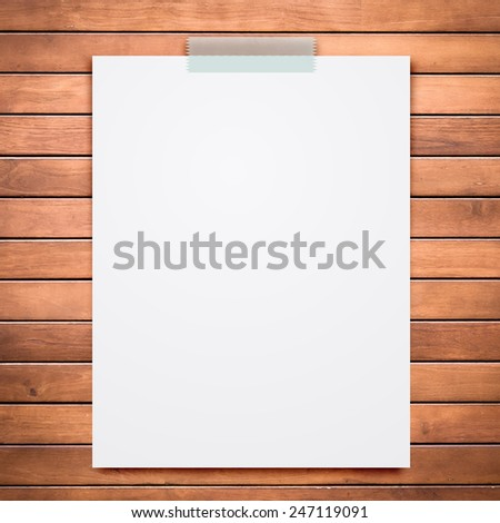 Empty white paper sheet stick on wooden board texture background. for your sample text or picture. - stock photo