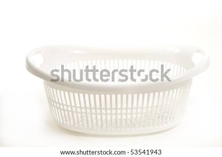 empty white plastic laundry basket on white