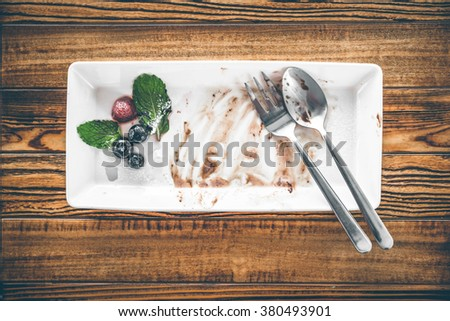 Empty white plate after eating dessert, After dessert is gone - From above - stock photo