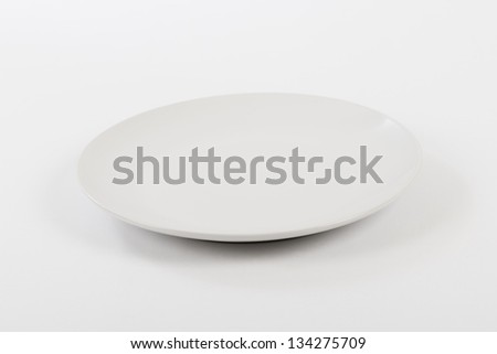 Empty white plate on a white background. - stock photo