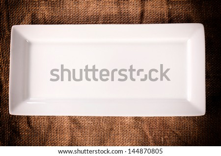 Empty white plate on the abstract background from above - stock photo