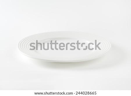 empty white plate on white background - stock photo