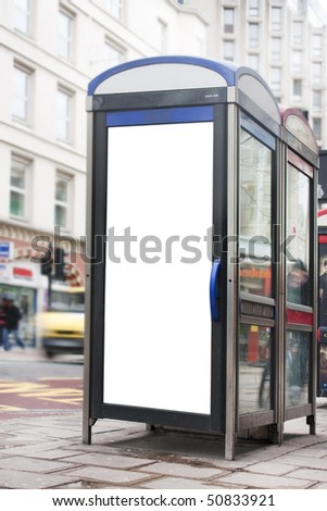 empty white poster advertising space on the side of a phone box