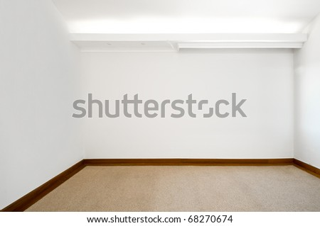 Empty white room with carpeted floor - stock photo
