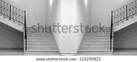 Empty white room with stairs