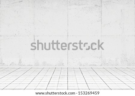 Empty white room with tiled floor and concrete wall - stock photo