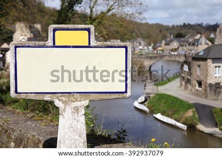Empty white sign on ancient french village background - stock photo