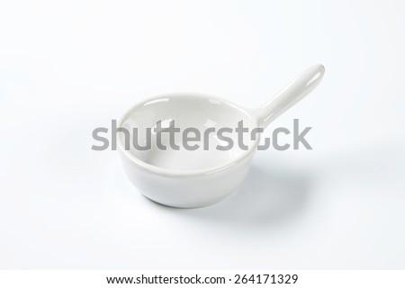 empty white skillet on white background - stock photo