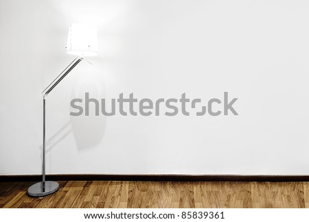 Empty white wall and wooden floor - stock photo