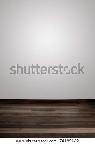 Empty white wall and wooden floor with a spot light in the wall - stock photo