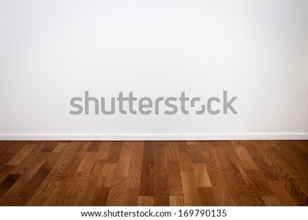 Empty white wall and wooden oak floor - stock photo