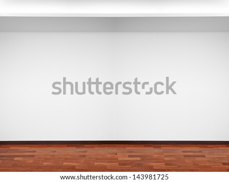 Empty white wall with light and wooden floor - stock photo