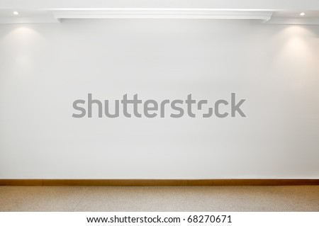 Empty white wall with 2 spot lights and carpeted floor - stock photo