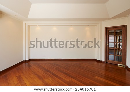 Empty white wall with 4 spot lights and wooden floor - stock photo
