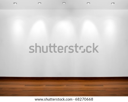 Empty white wall with 5 spot lights and wooden floor - stock photo